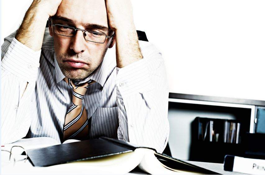 Stressed manager sighing
