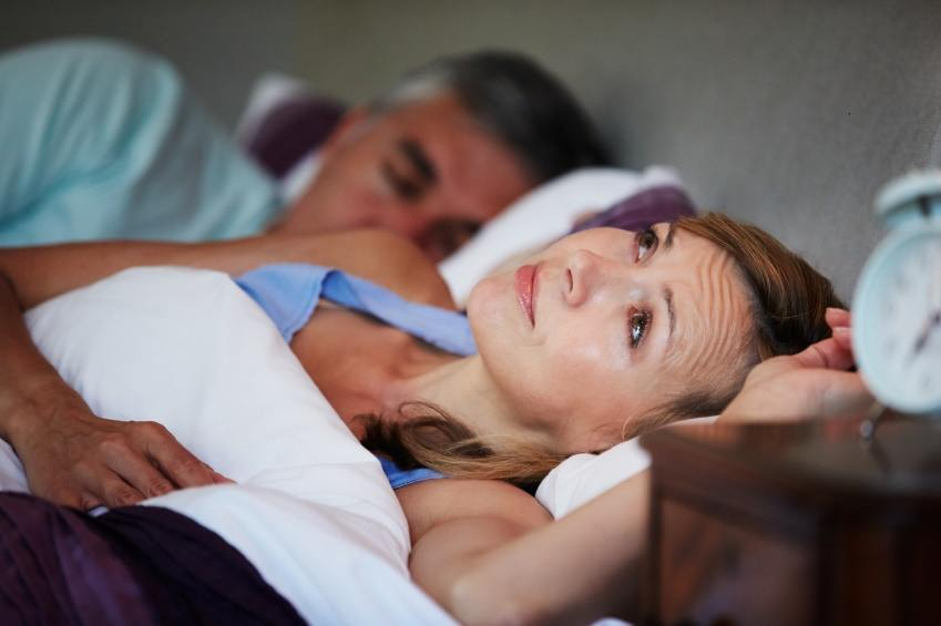 woman can't sleep in bed with her husband