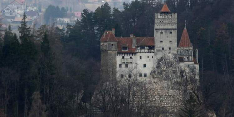 """BRAN, ROMANIA - MARCH 10:  Bran Castle, famous as """"Dracula's Castle,"""" stands among Transylvanian mountains on March 10, 2013 in Bran, Romania. Bran Castle's reputation as the supposed home to Dracula corresponds little with Bram Stoker's novel, nor did Vlad Tepes, the sadistic 15th-century Wallachian prince, ever live there. Nevetheless the castle retains the myth and tourists flock there in large numbers. Bran Castle, along with the mountainous region of southern Transylvania, which is home to Saxon fortified towns and churches, are among the asssets the Romanian government hopes will bring increasing numbers of tourists to the country. Both Romania and Bulgaria have been members of the European Union since 2007 and restrictions on their citizens' right to work within the EU are scheduled to end by the end of this year. However Germany's interior minister announced recently that he would veto the two countries' entry into the Schengen Agreement, which would not affect labour rights but would prevent passport-free travel.  (Photo by Sean Gallup/Getty Images)"""