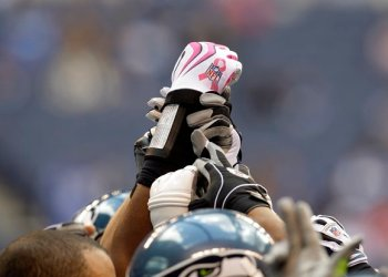 Seattle Seahawks plays wears pink gloves for Breast Cancer Awareness before an NFL football game in Indianapolis, Sunday, Oct. 4, 2009. (AP Photo/Darron Cummings)