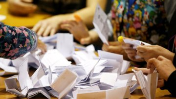 Ballots are tallied at a counting centre for Britain's general election in Boston