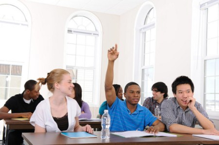 Diverse university students in a classroom.