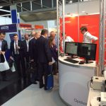 Optical engineers, Dave Biss and Will Rusin with booth visitors, Laser Munich, 2015