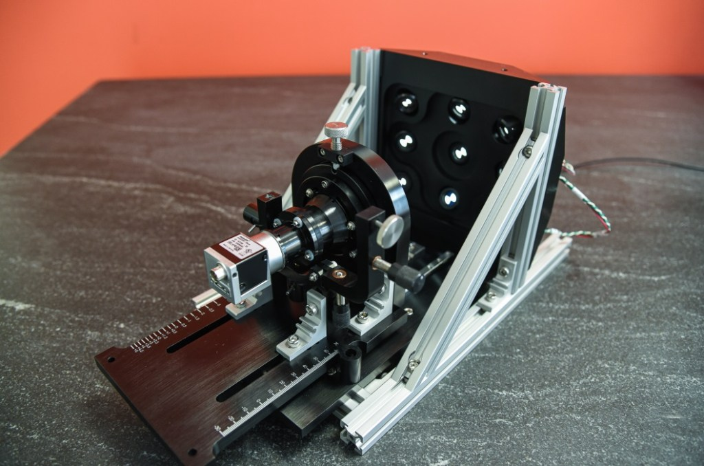 Figure 1 - Custom test and align station for an underwater camera. This fixture allows Optikos to compensate field tilt during camera integration, set focus, and test and  record full-field performance in one operation.