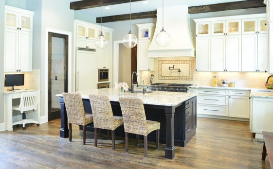 Kitchen Perimeter – Kabinart Cabinets. Wakefield door style, painted Starlite w/ Chocolate glaze. Kitchen Island – Sole Design Cabinetry. Jamestown door style, rustic alder wood, stained Espresso.