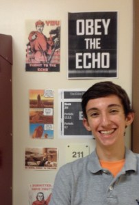Junior Mattingly Gerasomavich takes a break from managing prose submissions to reflect on the club's propaganda. These posters and graphics have been featured all across the school in a campaign to raise awareness about the magazine.