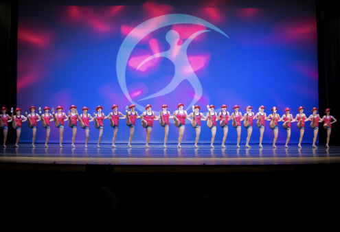 high kick line in a dance routine