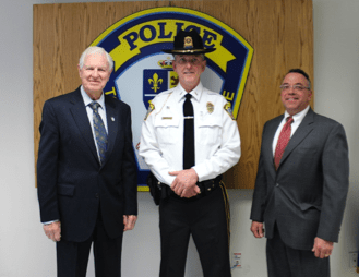 Police Commission Chairman Donald Lewis, Lieutenant Dennis Anderson, Police Commissioner Roy Cuzzocreo.