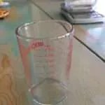 measuring glass shows tsp, TBSP, oz