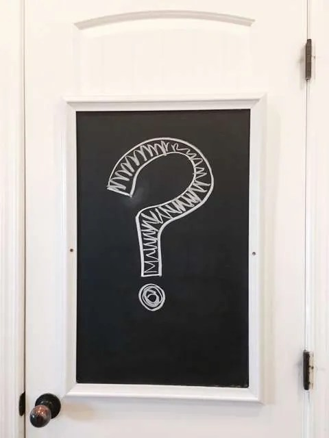Pantry door with a question mark