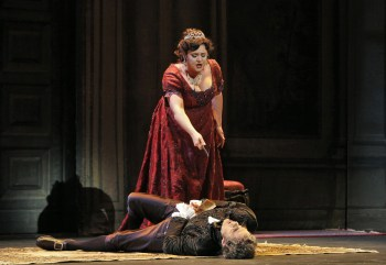 Tosca (Kara Shay Thomson) delivers a sharp rejoinder to Scarpia's (Mark Schnaible) attempted rape and confirmed corruption. © Portland Opera / Cory Weaver