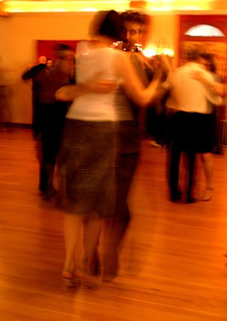 Alex Krebs and his wife dance during a Saturday milonga at Tango Berretin, a perfect pair.