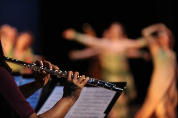 Imani Winds' Valerie Thompson and dancers. Photo: David Krebs