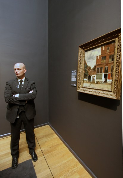 "On guard: standing watch over Johannes Vermeer's 1658 ""The Little Street."" Photo: Henk Pander"