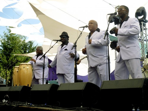 "The Relatives, formed in Dallas in 1970 and revived in 2009, kick it old-school with choreographed dancing, matching lavender suits, and occasional exclamations of ""Ow!"" and ""Good God!"""