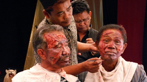 "The bad guys prepare for their shot in ""The Act of Killing"""