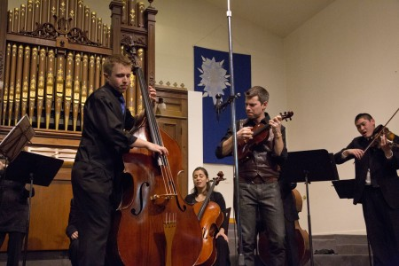 Bassist Karl Doty and guest violinist Kip Jones performed with A Far Cry in Jones's  Concerto for Violin, Double Bass, and String Orchestra. Photo  by John Green