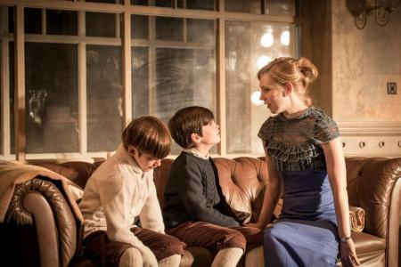 "The Young Vic's ""A Doll's House"": Pip Pearce (left) and Arthur Gledhill Franks with Hattie Monahan as Nora. Photo: Johan Persson"