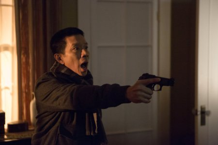 Sgt. Wu (Reggie Lee) draws a bead on the neighbor's house. NBC photo