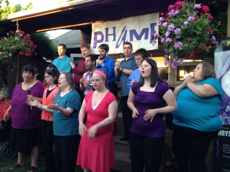 Abbi Dunham (right, in purple blouse) sings with the PHAME choir.