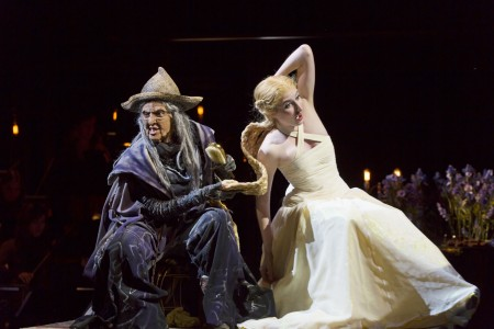 "In OSF's ""Into the Woods"" Miriam A. Laube tugs  on Royer Bockus's golden hair/Photo  T. Charles Erickson"