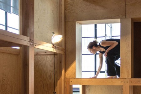"Tess balances on the ""Souvenir"" house at the Baryshnikov Arts Center in New York. Photo courtesy Rachel Tess"