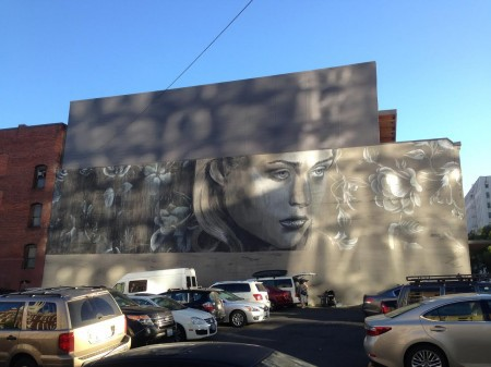 "The painting's on the wall: Rone's ""Every Rose Has Its Thorns."" Photo: Patrick Collier"