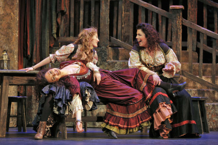Katrina Galka (left) as Frasquita, Sandra Piques Eddy as Carmen, Angela Niederloh (right) as Mercedes at Portland Opera. Photo: Cory Weaver