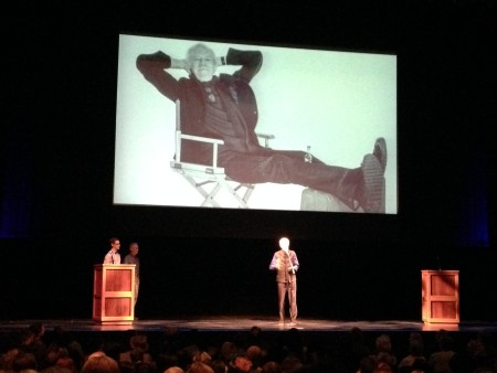 Tobias Andersen accepts his lifetime achievement award beneath a giant photo of himself at ease. Photo: Laura Grimes
