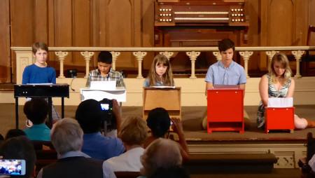 "Piano students play Jennifer Wright's ""X Chromosome"" at In Good Hands. Photo: Jennifer Wright."