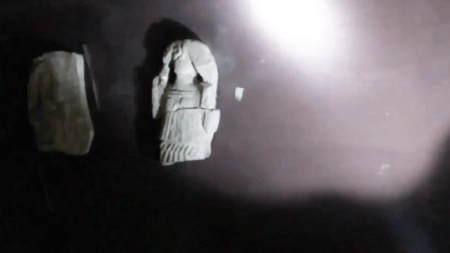 "Video still, ""2000 year old sculpture makes violent introduction""/Ryan Woodring"