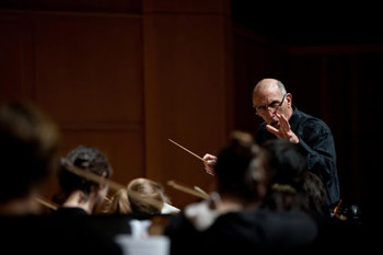 Schiff conducts the Reed College orchestra.