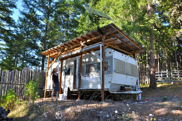 """Renee Couture looks up at her artist studio """"trailer"""" situated on acreage in the central Southern Oregon region./Sabina Poole"""