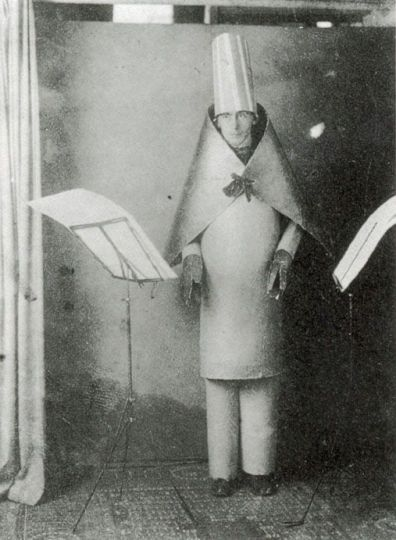 In the Dada beginning: Hugo Ball performing a century ago at the Cabaret Voltaire in Zurich. Wikimedia Commons.