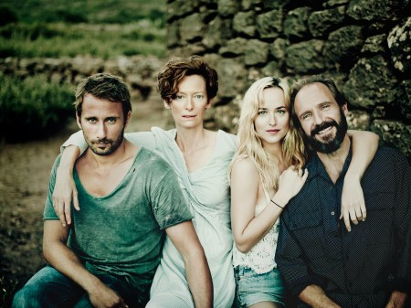 "Matthias Schoenaerts as ""Paul De Smedt,"" Tilda Swinton as ""Marianne Lane,"" Dakota Johnson as ""Penelope Lanier,"" and Ralph Fiennes as ""Harry Hawkes"" in A BIGGER SPLASH. Photo courtesy of Fox Searchlight Pictures. © 2015 Twentieth Century Fox Film Corporation All Rights Reserved"