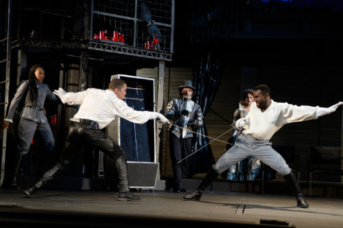 Horatio (Christiana Clark), Osric (Benjamin Bonenfant) and Gertrude (Robin Goodrin Nordli) watch as Hamlet (Danforth Comins) and Laertes (Tramell Tillman) engage in a fencing match. Photo: Dale Robinette, Oregon Shakespeare Festival