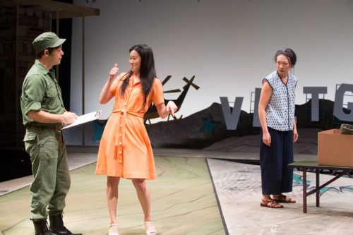 Tong (Jeena Yi) doesn't spur Bobby's (Paco Tolson) advances, to the dismay of her mother, Huong (Amy Kim Waschke). Photo: Jenny Graham, Oregon Shakespeare Festival