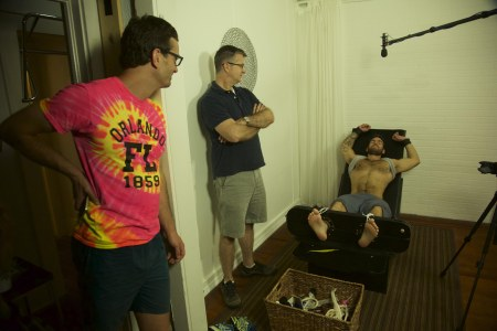 David Farrier, Richard Ivey, and a tickle subject in TICKLED, a Magnolia Pictures release. Photo courtesy of Magnolia Pictures.