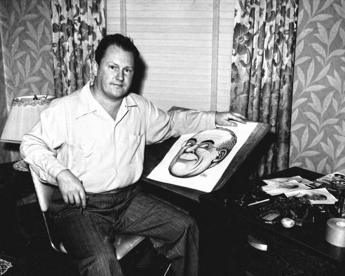 Cartoonist Basil Wolverton at his drawing table, about 1950. © Basil Wolverton Estate
