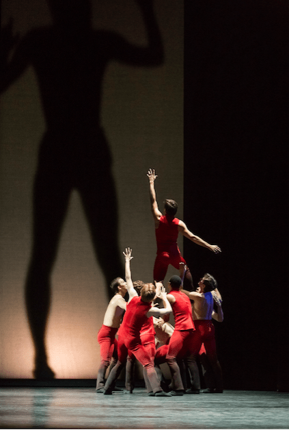 "Michael Linsmeier with other dancers and a large shadow in ""Giants Before Us."" Photo: Blaine Truitt Covert"