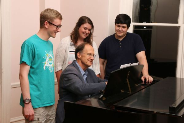 Young composers Wesley Coleman, Marissa Lane-Massee, Joseph Miletta with Dr. Robert Kyr. Photo: Eugene Symphony.