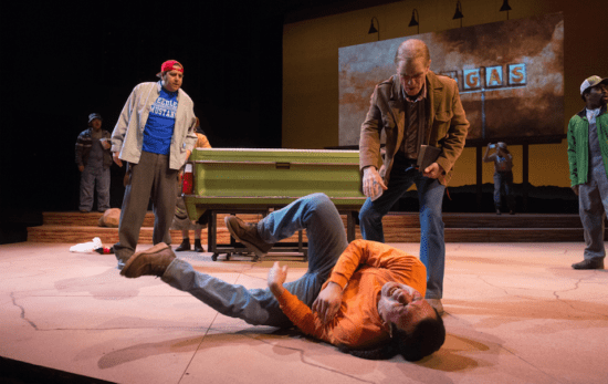 "Mark Murphey (holding book) plays William Joad, who meets unexpected relative Martin Jodes, played by Tony Sancho (on ground), in Octavio Solis' ""Mother Road"" at Oregon Shakespeare Festival. Photo by: Jenny Graham/Oregon Shakespeare Festival"