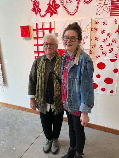 "Salem artist Bonnie Hull (left) and Sarah Rosella Cuevas, a 2019 George Fox University graduate in arts administration, take a break during  installation of Hull's ""Little Me"" exhibit at the university, which was curated by Cuevas.  Photo courtesy: Bonnie Hull"
