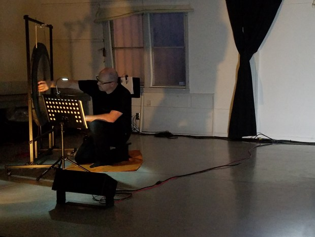 Matt Hannafin performs Eva-Maria Houben's 'The Crickets of Raspberry Island' at Extradition's summer concert. Photo by Glenn Sogge.