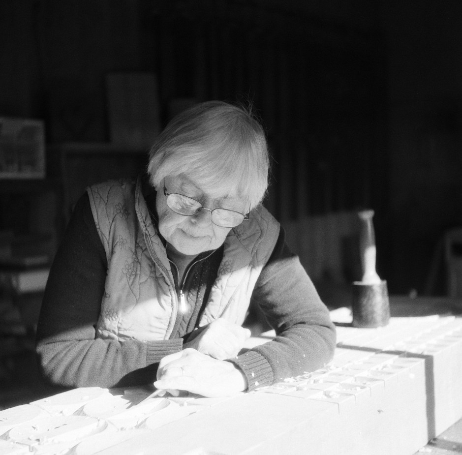 Monica Setziol-Phillips carves at the same bench her father, Leroy Setziol, used. A resident of Sheridan, she is former president of the Yamhill County Cultural Coalition. Photo by: Stuart Eagon