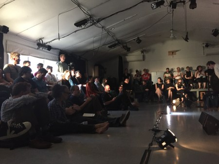 Sitting in a room listening. Audience at Extradition's summer concert at Performance Works NW. Photo by Matt Hannafin.