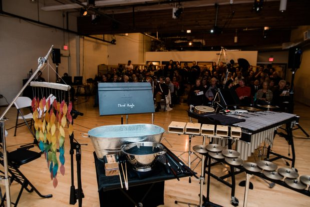 """Percussion and audience at Third Angle's """"Homecomings"""" concert at New Expressive Works, October 2017. Photo by Kenton Waltz."""