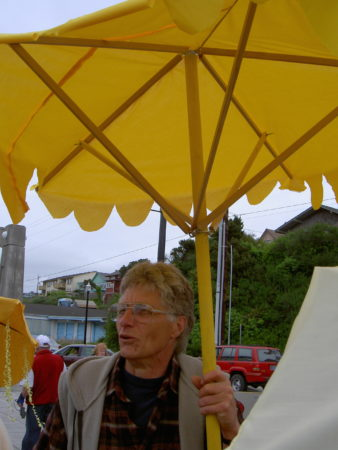 "Juergen Eckstein invited all of Newport to join ""The Yellow Umbrella Project"" in 2004. ""First individuals, forming trickles as others join creating streams of yellow umbrellas as they move closer towards the center of Nye Beach where they gather as a sea of yellow,"" he wrote on his website. Photo courtesy: Gary Lahman"