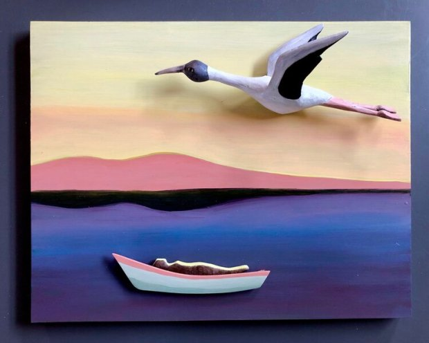 """""""A dream of flying,"""" by Stan Peterson of Portland (carved and painted basswood on birch panel, 11 by 14 by 4 inches, April 2020). Peterson says of his piece: """"The reclining figure emanating the yellow light of sky rests in a boat adrift. There is a sort of reverie to sheltering in place. I'm also feeling adrift, waiting to fly again."""""""
