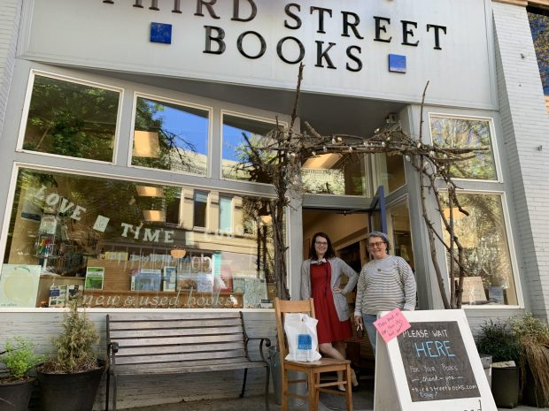 Sylla McClellan (right) laid off her staff at Third Street Books when the coronavirus forced the shop to close its doors, but has hired back one employee. Emily Kelly (left) hosts online story times, streaming Thursday mornings on Facebook. Photo by: David Bates